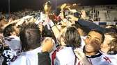 The Newfield football team celebrate with their trophies