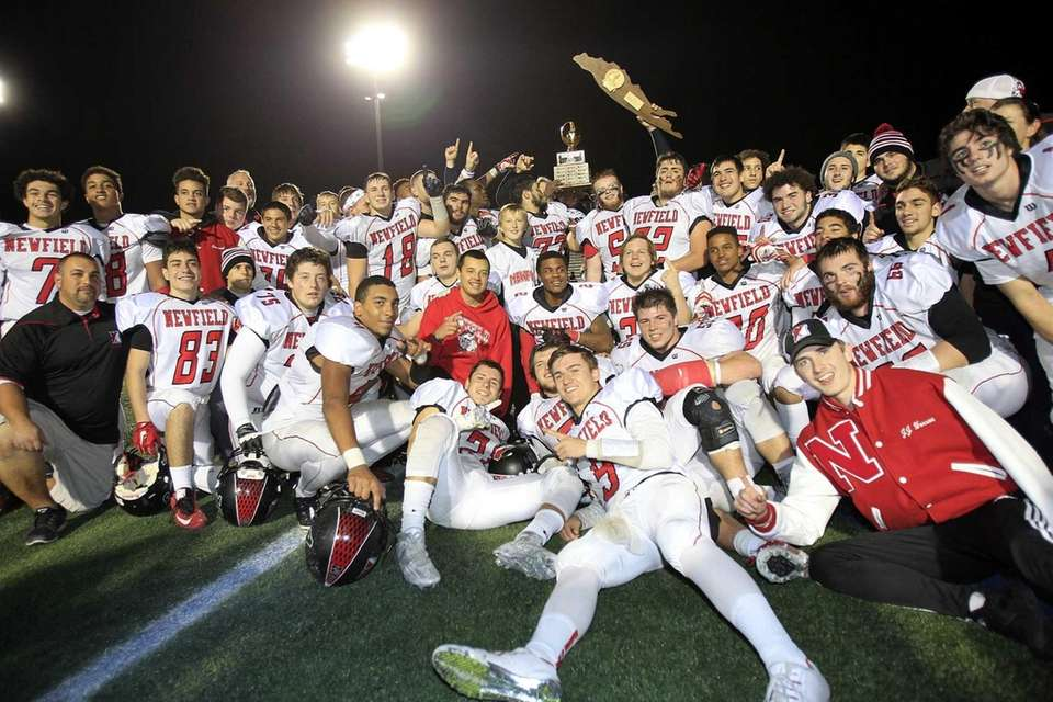 The Newfield football team pose for a team