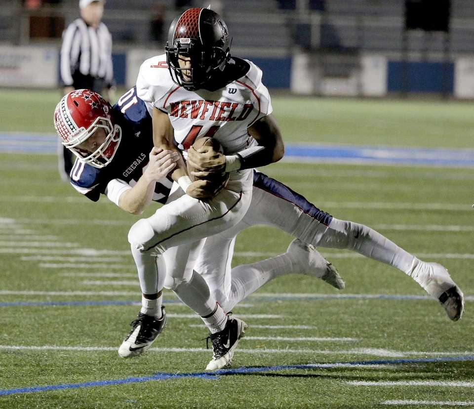 Newfield runningback Isaiah Israel (4) holds onto a