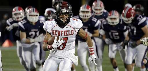 Newfield wide receiver, cornerback Elijah Riley (8) leaves