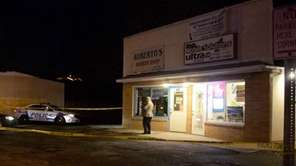 Police investigate the scene of a robbery on