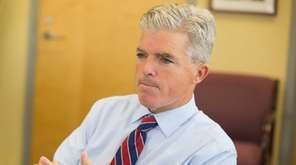 Steve Bellone sits in his office a day