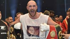 Britain's new world champion Tyson Fury celebrates with