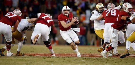 Kevin Hogan #8 of the Stanford Cardinal runs