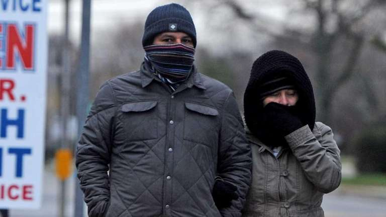 A couple walks arm-in-arm along Route 111 Sunday,