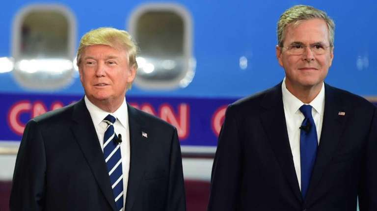 Donald Trump and Jeb Bush look on during