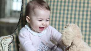 Princess Charlotte with her cuddly toy dog, at