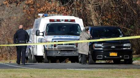 Suffolk County police are at Mooney Pond and