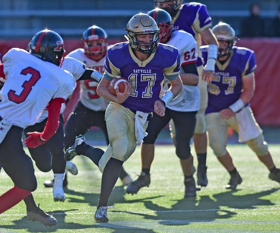 Sayville's Jack Coan runs for yardage during the