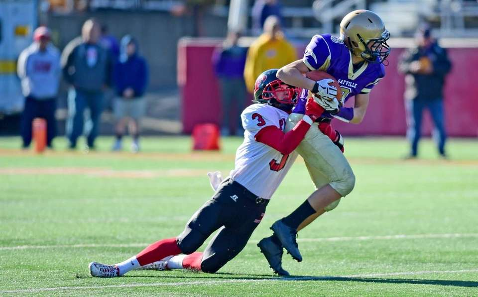 Sayville's Jason Intermesoli runs for yardage against Plainedge's