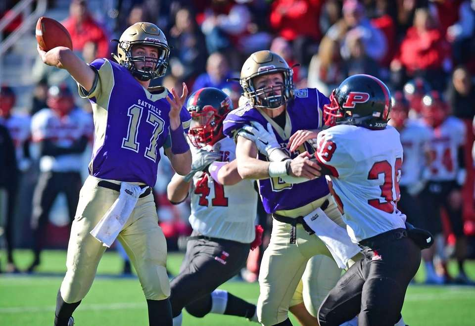 Sayville's Jack Coan drops back to pass during