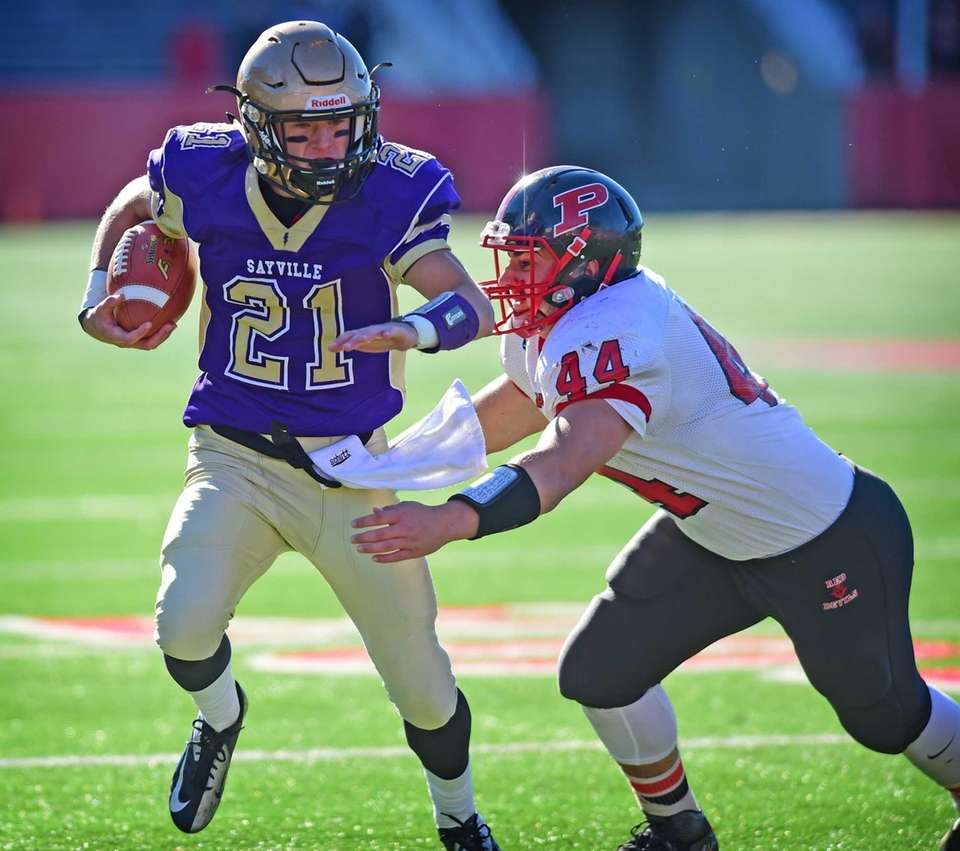 Sayville's Ashton Bradley drives for yardage against Plainedge's