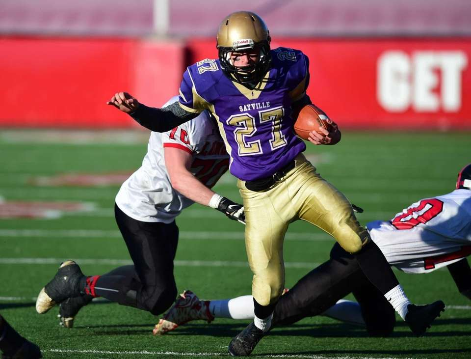 Sayville's Derrick Fatigate runss for yardage during the