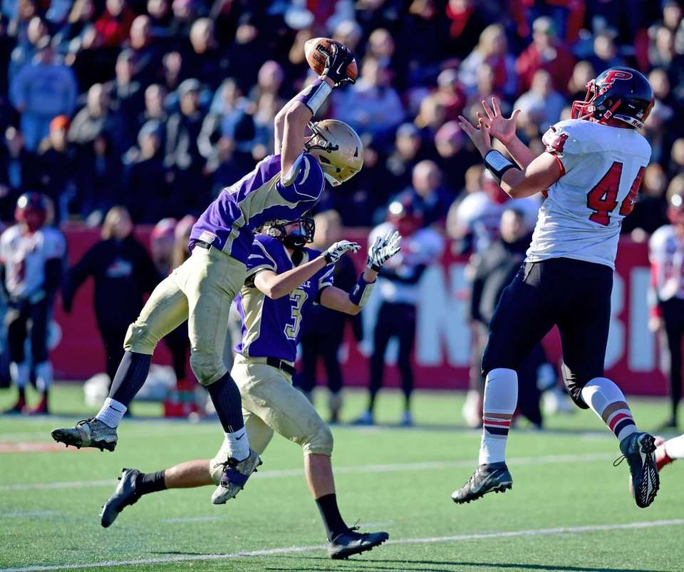 Sayville's Nick Casazza intercepts a pass intended for