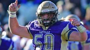 Sayville's Mike Leach celebrates a play during the