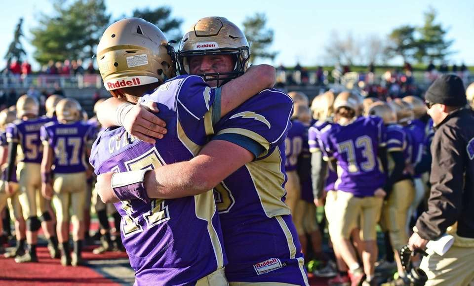 Sayville's Jack Coan and Mike Leach celebrate after