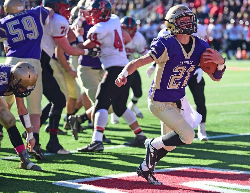 Sayville's Ashton Bradley celebrates a touchdown during the