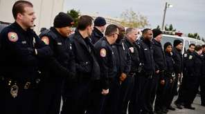 Nassau County police officers, along with members of