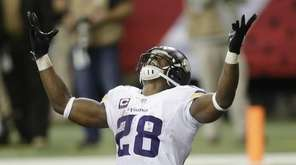 Minnesota Vikings running back Adrian Peterson (28) celebrates