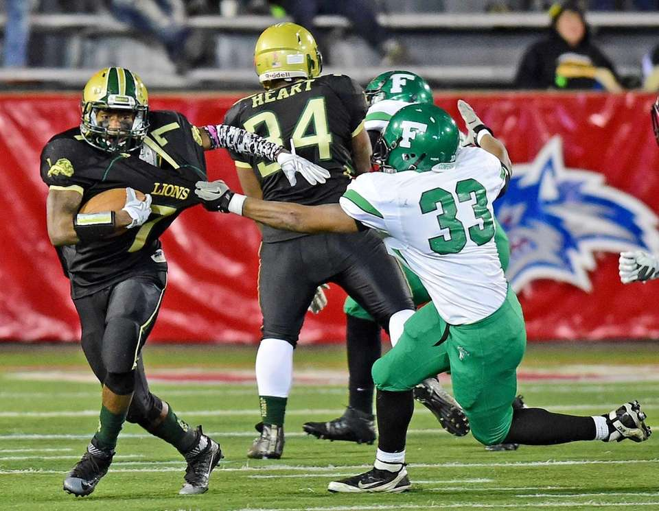 Longwood's Khalil Owens runs for yardage past Farmingdale's