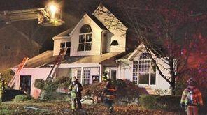 Firefighters battle a blaze in house on Ferraro