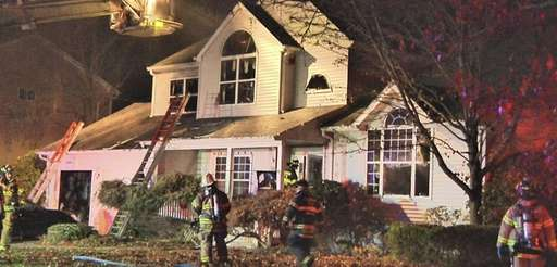 Firefighters battle a blaze in house on Ferraro