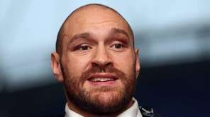 Tyson Fury speaks at a press conference at