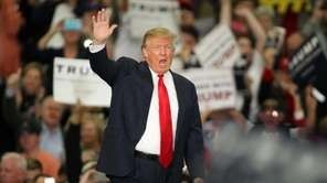 Republican presidential candidate Donald Trump waves during a