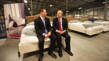 Sleepy's chief operating officer Adam Blank, left, with