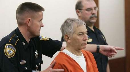 Robert Durst is escorted into the courtroom for