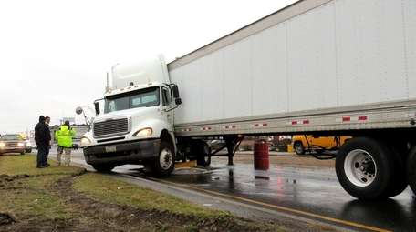 A jackknifed tractor-trailer closed eastbound Sunrise Highway in