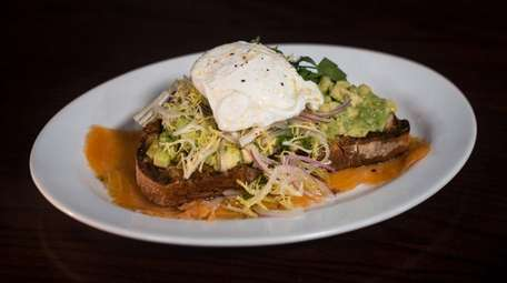 Avocado toast with poached egg and salmon is