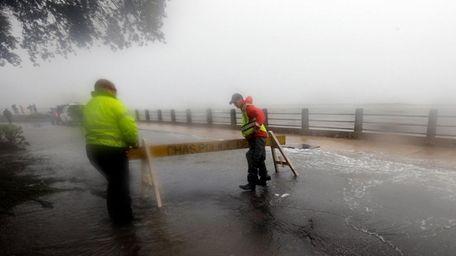 Police set up a barricade on a flooded