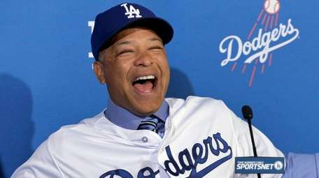 Los Angeles Dodgers' Dave Roberts smiles as he