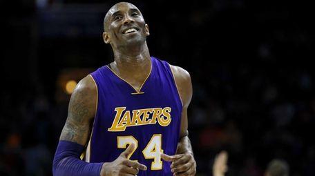 Los Angeles Lakers' Kobe Bryant smiles as he