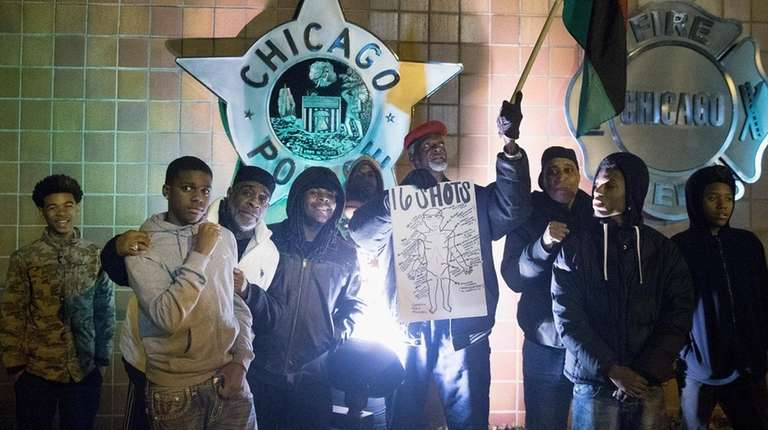 Demonstrators pose for a picture in front