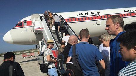 Passengers board an Air Koryo plane at the