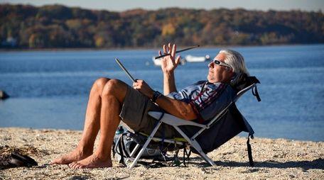 Joe Costa, 57, of Hicksville, twirls his drumsticks