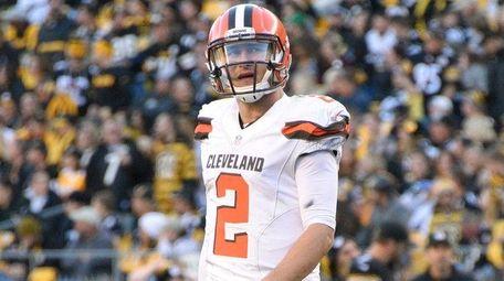 Cleveland Browns quarterback Johnny Manziel walks off the