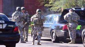 A swat team arrives at the scene of