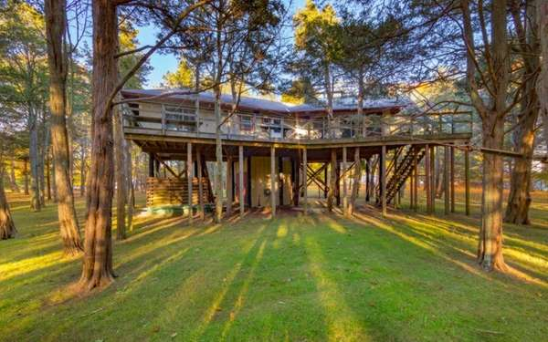 This two-bedroom treehouse is included with another house