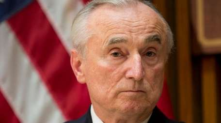 NYPD Commissioner William Bratton listens to a question