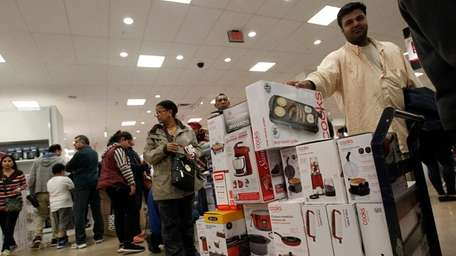 Shafqat Wasi, of Hicksville, along with other shoppers