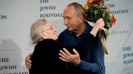 Krystyna Jakubowska (L), of Poland, hugs Michael Hochberg,