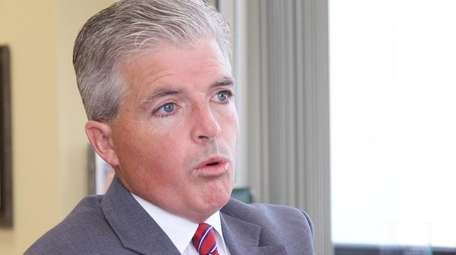 Suffolk County Executive Steve Bellone talks with reporters