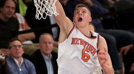 Knicks forward Kristaps Porzingis scores on a