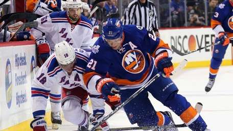 Marc Staal of the New York Rangers trips