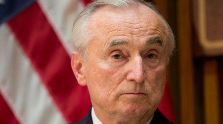 New York Police Department Commisioner William Bratton listens
