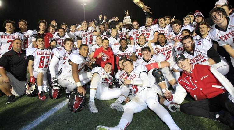 Newfield celebrates after defeating MacArthur, 41-33, in the