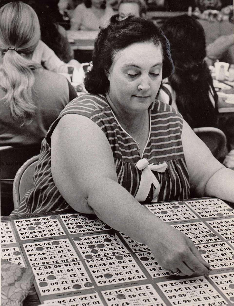 Rita Duarte of Massapequa plays her bingo card